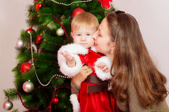 Mother and baby  at Christmas Tree Stock Photography