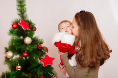 Mother and baby  at Christmas Tree Royalty Free Stock Image