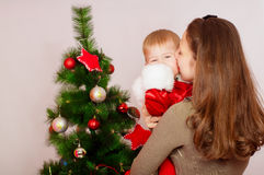 Mother and baby  at Christmas Tree Royalty Free Stock Photography