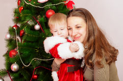 Mother and baby  at Christmas Tree Royalty Free Stock Images