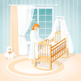 Mother and baby in the cot. A children`s room. Night. Stock Photo