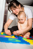 Mother and baby - cutting nails Royalty Free Stock Photography