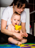 Mother and baby - cutting nails Royalty Free Stock Photo