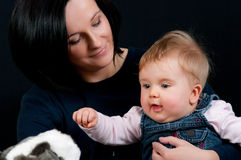 Mother and baby daughter Stock Images