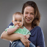 Mother and baby daughter - cute image Stock Photos