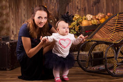 Mother with baby daughter on Halloween party Royalty Free Stock Image