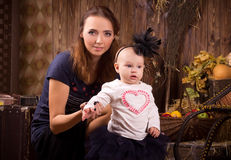 Mother with baby daughter on Halloween party Stock Image