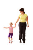 Mother and baby daughter holding hands and jogging. Stock Image