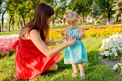 Mother and baby daughter hugging i Stock Images