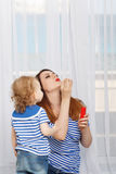 Mother and baby daughter inflate bubbles Stock Image