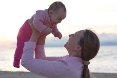 Mother and Baby Daughter Outdoors Royalty Free Stock Photo