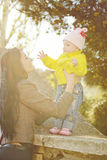 Mother and baby daughter in spring time Stock Images