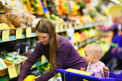 Mother and baby daughter in supermarket Stock Photography