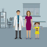 Mother and baby daughter visit doctor`s office. Family healthcare concept. Stock Photos