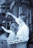 Mother and baby decorating Christmas tree Stock Photography