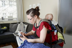 Mother with baby and digital tablet Stock Photos