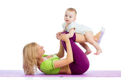 Mother with baby do fitness exercises Stock Images