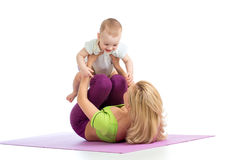 Mother with baby do fitness exercises Royalty Free Stock Photography