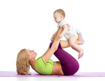 Mother with baby do gymnastic and fitness Stock Photo