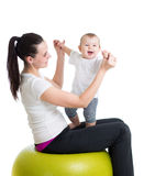 Mother and baby do gymnastics on ball. Mother and baby with  gymnastic ball Royalty Free Stock Image