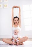 Mother and baby doing exercise Stock Images