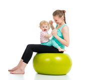 Mother with baby doing gymnastic on ball. Mother with baby having fun with  gymnastic ball Stock Photo