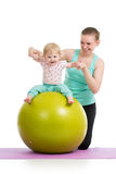 Mother with baby doing gymnastic on fitness ball. Mother with baby having fun with  gymnastic ball Royalty Free Stock Photography