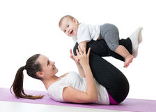 Mother with baby doing gymnastics exercises Royalty Free Stock Photography