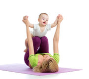 Mother with baby doing gymnastics. And fitness exercises Stock Image