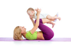 Mother and baby doing gymnastics Royalty Free Stock Photography