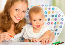 Mother and baby draw color pencil Stock Image