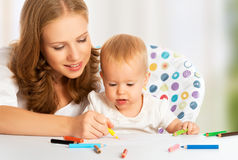Mother and baby draw color pencil Stock Images