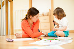 Mother and baby drawing on  floor Stock Images