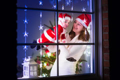 Mother and baby dress as Santa Stock Image