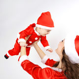 Mother and baby dressed in Christmas Santa Stock Photos