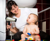 Mother and baby - drying hairs Royalty Free Stock Photos