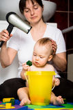Mother and baby - drying hairs Stock Photos