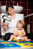 Mother and baby - drying hairs Royalty Free Stock Photo