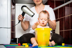 Mother and baby - drying hairs Royalty Free Stock Image