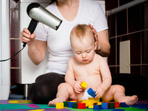 Mother and baby - drying hairs Stock Photo