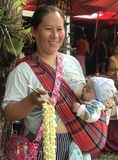 Mother & Baby. Earning living while feeding the baby, thailand Royalty Free Stock Photos
