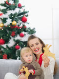 Mother and baby eating Christmas cookies Royalty Free Stock Photos