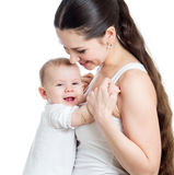 Mother and baby embrace. Maternity concept. Royalty Free Stock Image