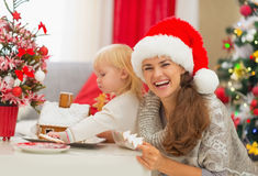 Mother and baby enjoying Christmas cookies Stock Images