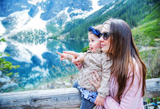 Mother with a baby on family summer vacation Stock Images