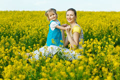 Mother with baby on field Stock Photo