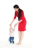 Mother with baby. First steps. Stock Photos