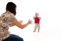 Mother and baby first walking steps royalty free stock image