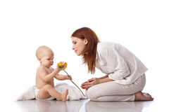 Mother and baby with flower. Royalty Free Stock Photography