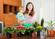 Mother and baby with flowering plants Royalty Free Stock Images